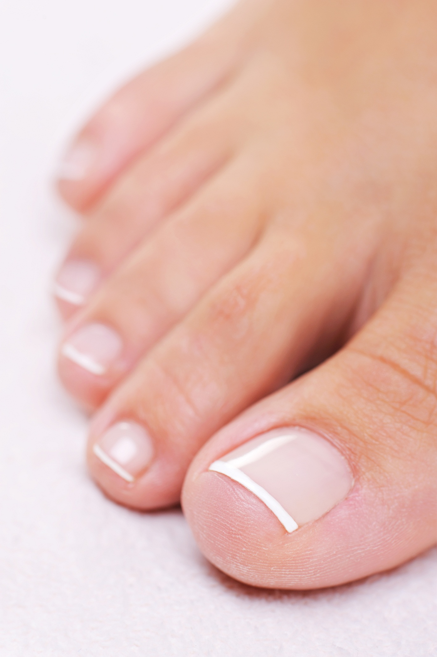 Female foot with a french pedicure